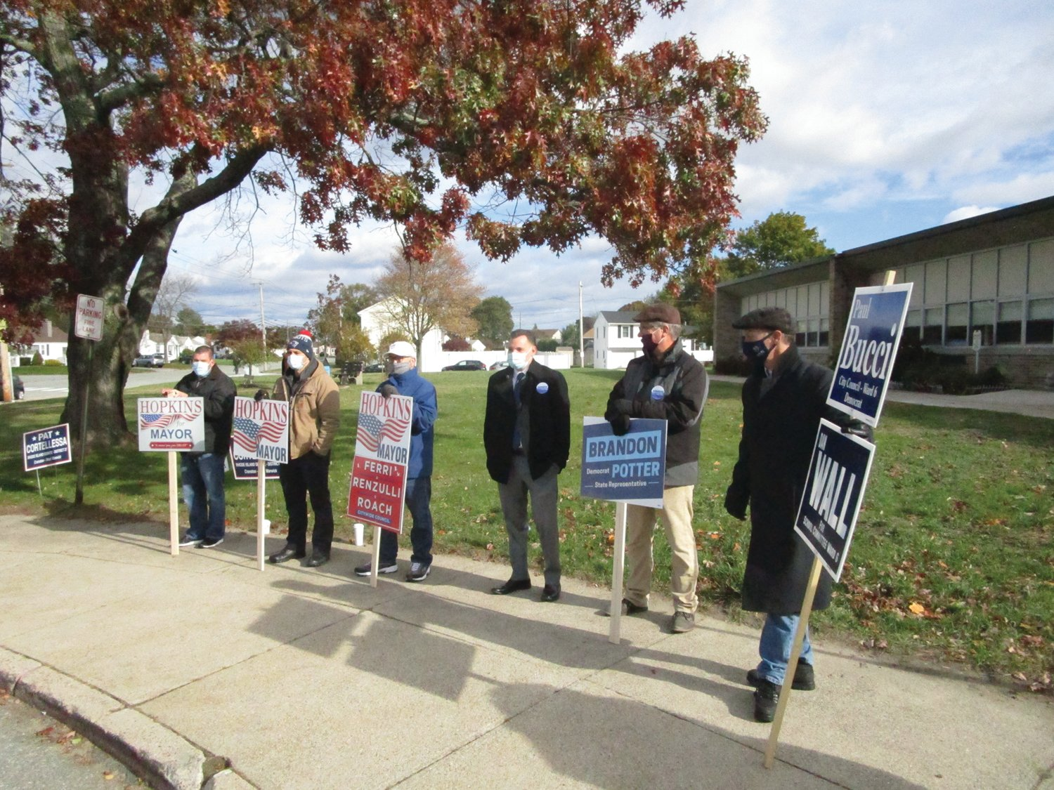 FINAL PITCH: House District 16 candidate Brandon Potter, third from right, and School Committee Chairman Daniel Wall, right, who is unopposed for reelection, were among those campaigning outside Garden City Elementary School Tuesday morning.