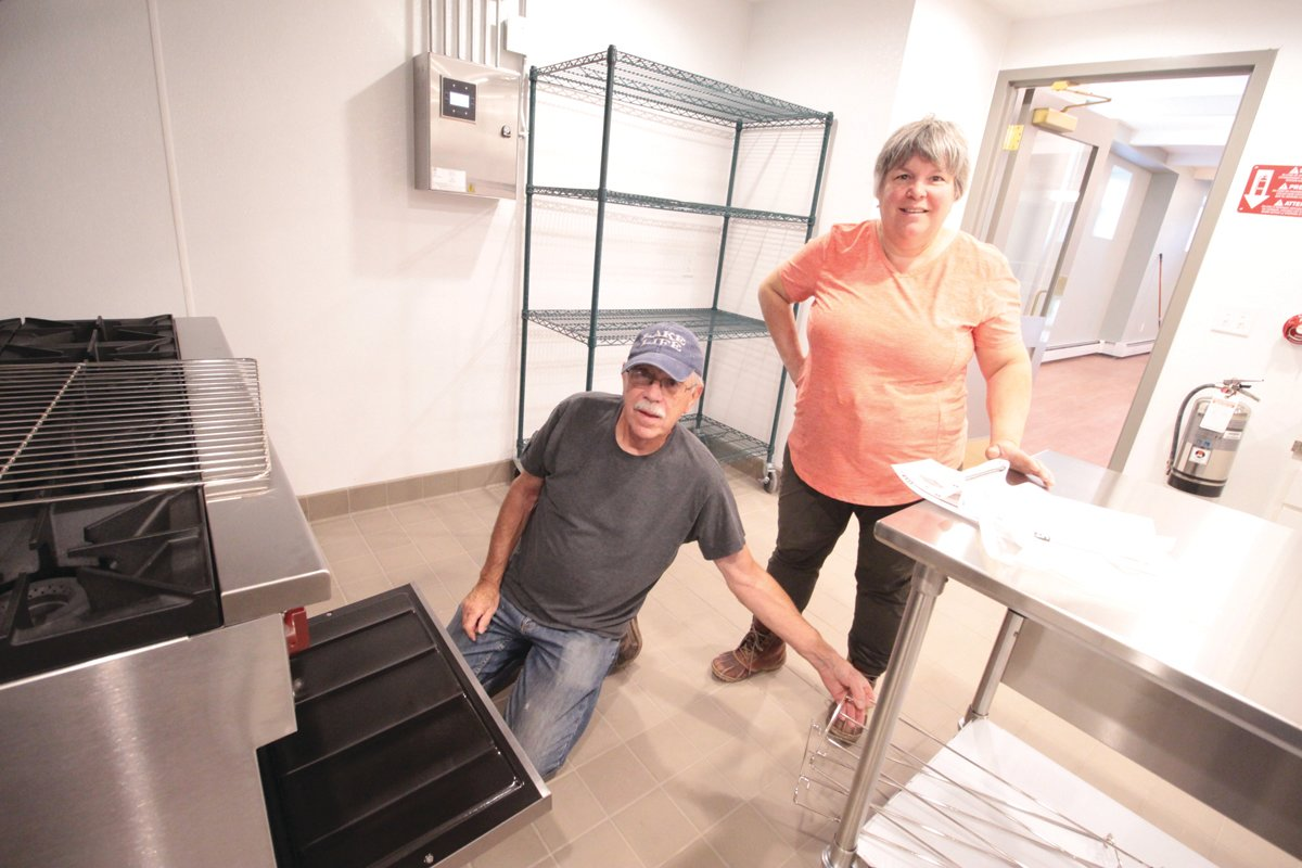 A LOT TO LEARN: Woodbury Union parishioners George Tarring and Susan Hay are finding their way around the nearly completed church including how to operate the stove.