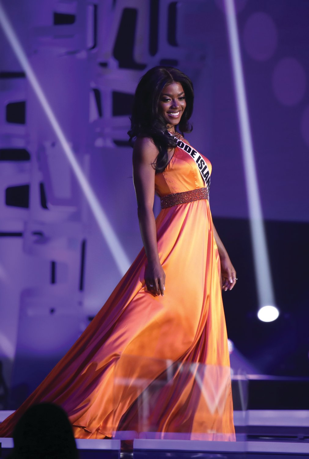 Jonet Nichelle, Miss Rhode Island USA 2020, on stage in a Sherri Hill gown, an official sponsor of the 2020 Miss USA competition, at the Miss USA Preliminary Competitions, on November 6, 2020 at Graceland in Memphis, Tennessee.