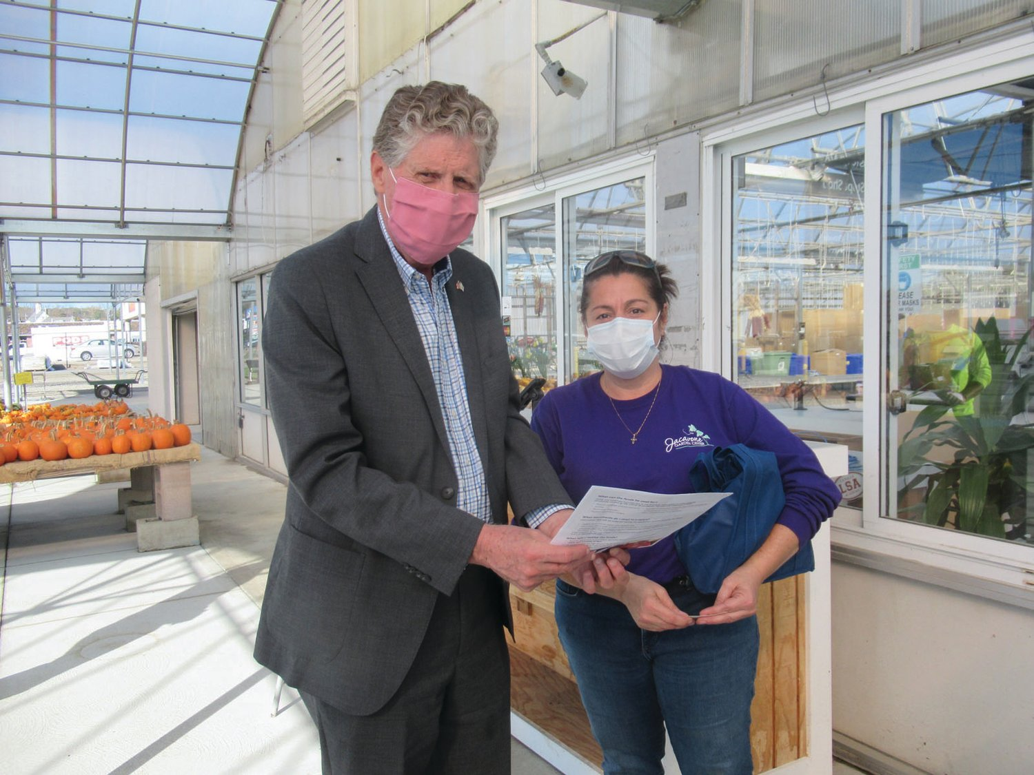 CONNIE'S CORNER: Connie Jacavone, whose family owns and operates the iconic Jacavone Garden Center in Johnston, accepts a special informational package from Lt. Gov. Dan McKee during his Restore RI Grant Tour.