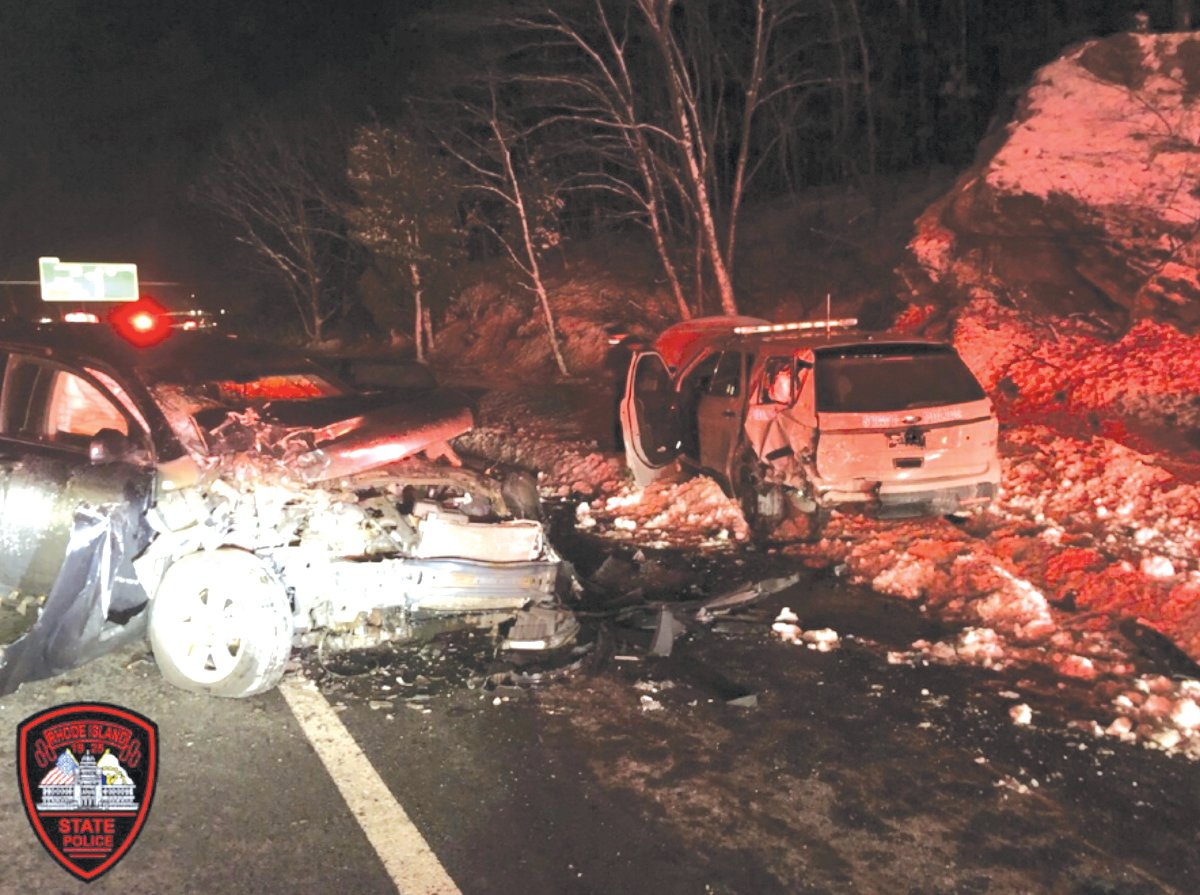 NO SERIOUS INJURIES: This photo provided by Rhode Island State Police shows the aftermath of a collision involving a stopped cruiser and an allegedly impaired motorist on Saturday night.