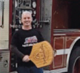 ONE SLICE AT A TIME:  Shawn Finnigan, pictured here, is looking forward to serving fresh pizza from the Hook n Ladder Pizza Co. truck.