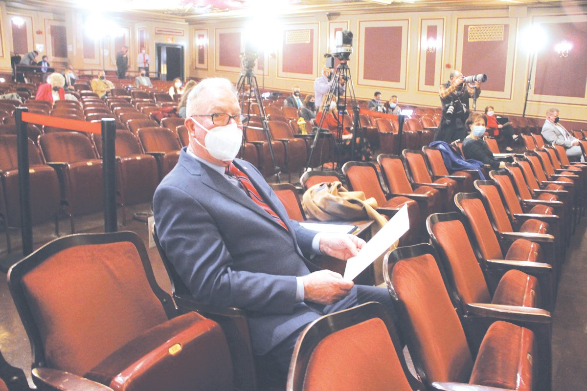 READY FOR THE SHOW TO START: Rep. Joseph McNamara settles into his seat in the Veterans Auditorium, which allows legislators to be to be more distanced than State House chambers.