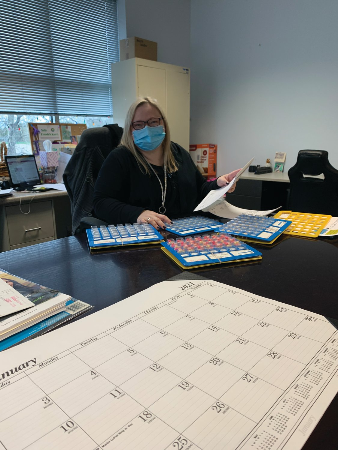 Healthy Transitions Nurse Julie Hendrickson conducts medication reconciliation and packing for clients.