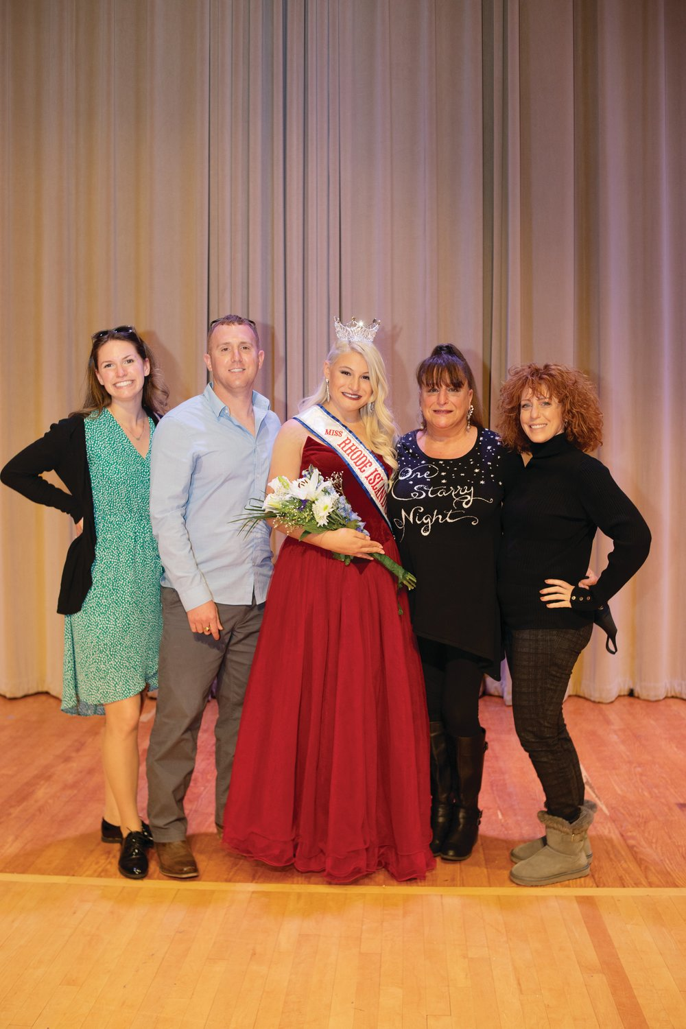 JOHNSTON REPRESENTED: Allegra Graziano poses with her family after being crowned Miss Rhode Island Collegiate America this November.