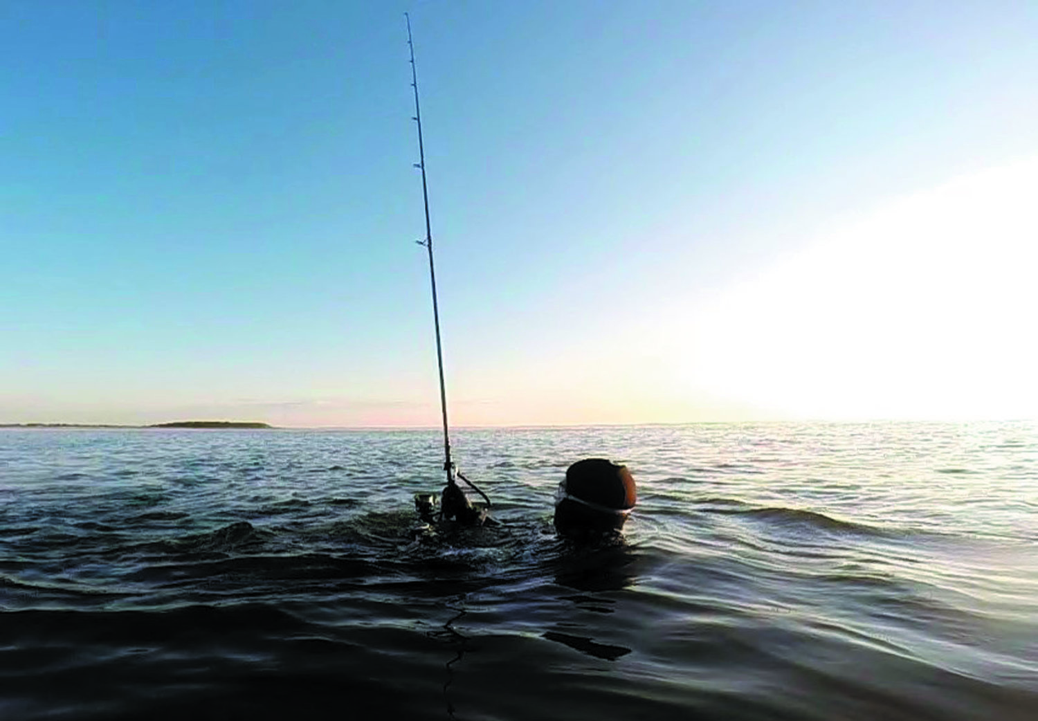 "EXTREME: ""Skishing"" is an extreme form of surfcasting where the angler wearing a wet suit floats in the water and is able to swim, cast and fish.Julio Silvia skishing for striped bass, will be guest speaker at a January 25 RISAA Smart Surfcasting seminar."