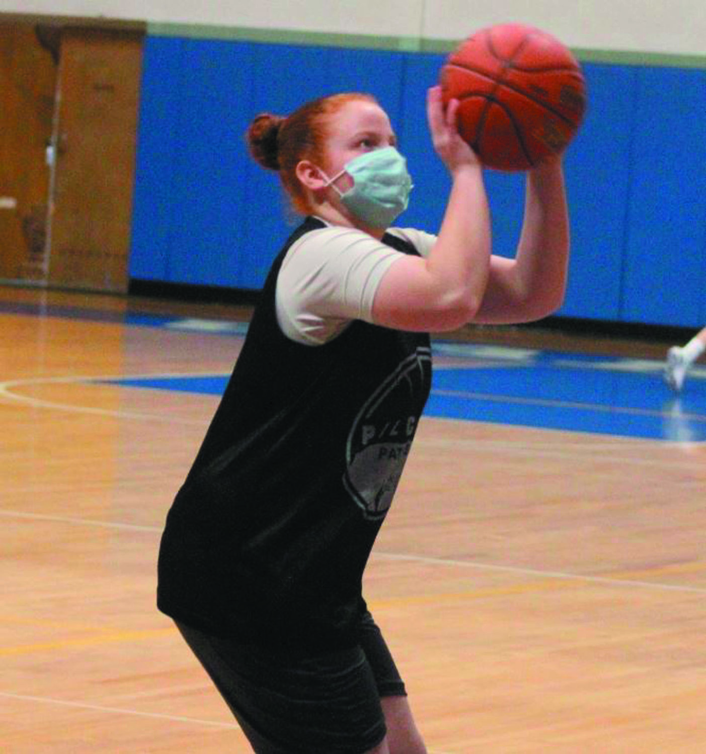 FOR THREE: Pilgrim's Kelsey Burr puts up a shot at a recent practice.