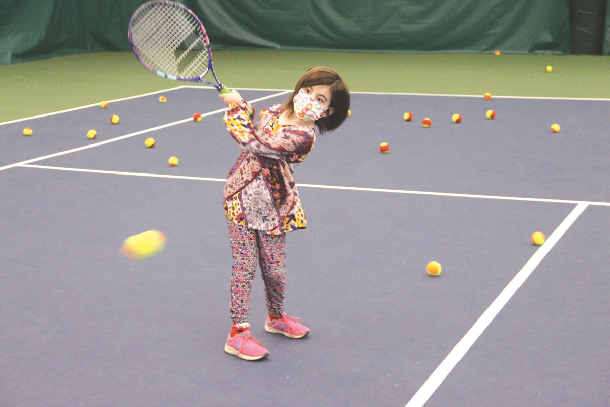 FOLLOW THROUGH: Maeve Galligan hits a backhand during her Saturday morning lesson at Tennis Rhode Island.