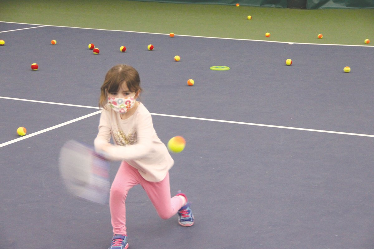 SWINGING 5: Fiona, age 5, hits a forehand.