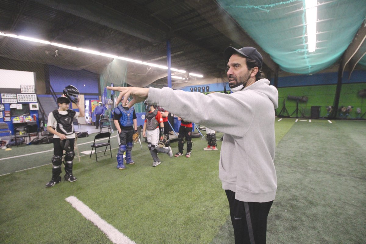 HE WON THE BET: John Mello, a founder of the Rhode Island Baseball Institute, challenged young catchers to either perform 110 squats or put their faith in one of the group to complete a drill in four seconds. If the player failed the drill, all the players would perform twice the number of squats.