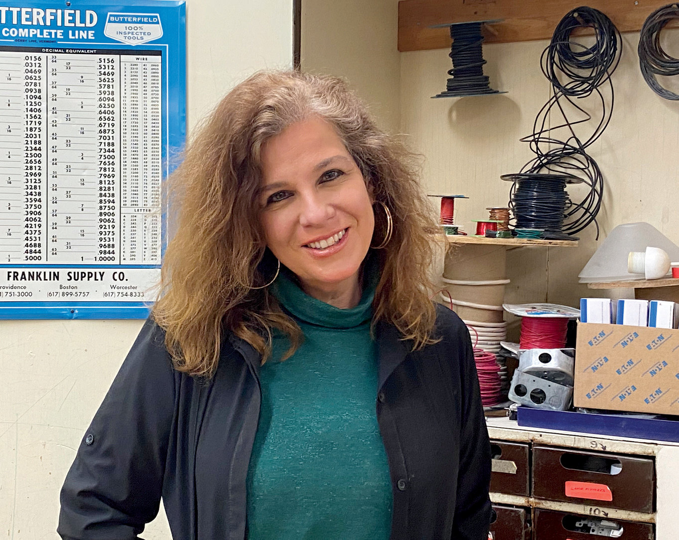 MORE THAN A MENTOR: DelSanto stands in front of one of the many electrical equipment cabinets around the room. Should she win the LifeChanger of the Year Award, the prize money will go right back into her classroom.