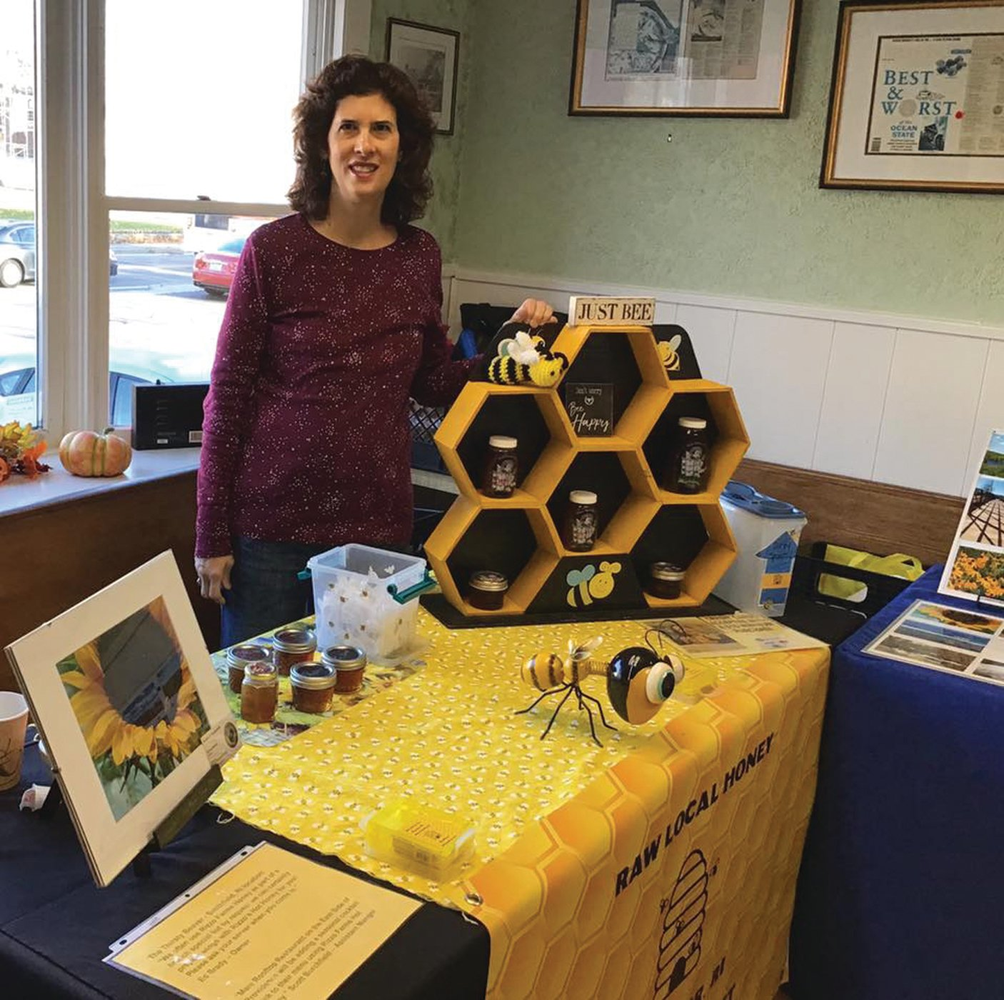 BUY LOCAL: Sue Baron is pictured during indoor and outdoor markets, pre-COVID, selling Rizzo Farms honey. To purchase honey from Rizzo Farms, contact Baron at bbhoney@cox.net.