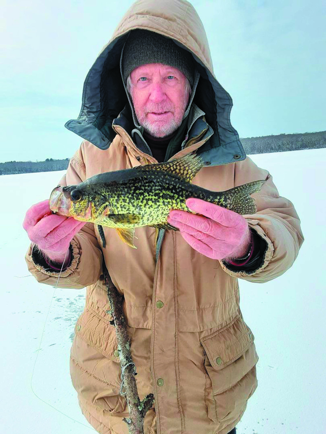 ICE FISHING GOOD: Anglers are catching pickerel, perch and crappie like this 14-inch crappie caught on a South County Pond by Gil Bell. Check safe ice conditions with local authorities.
