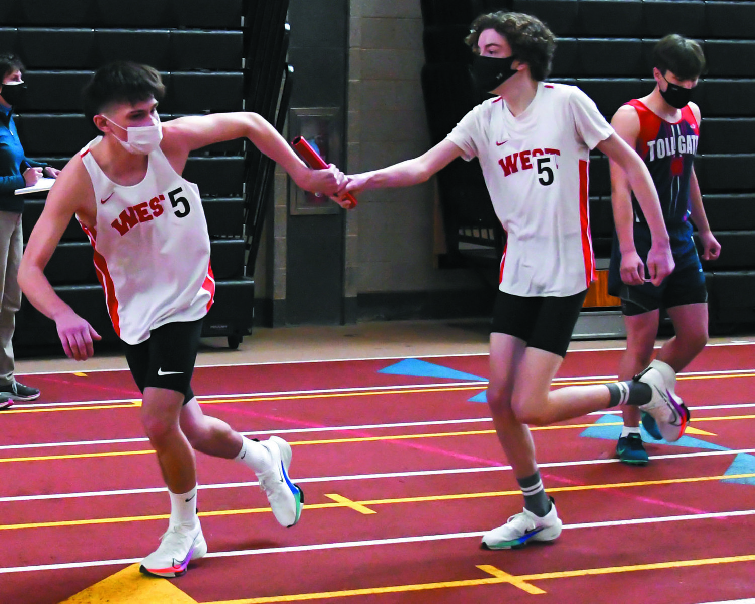 PASS THE BATON: Cranston West's Kris Degaitas and Luke Schmidt pass the baton during one of the team's relay races