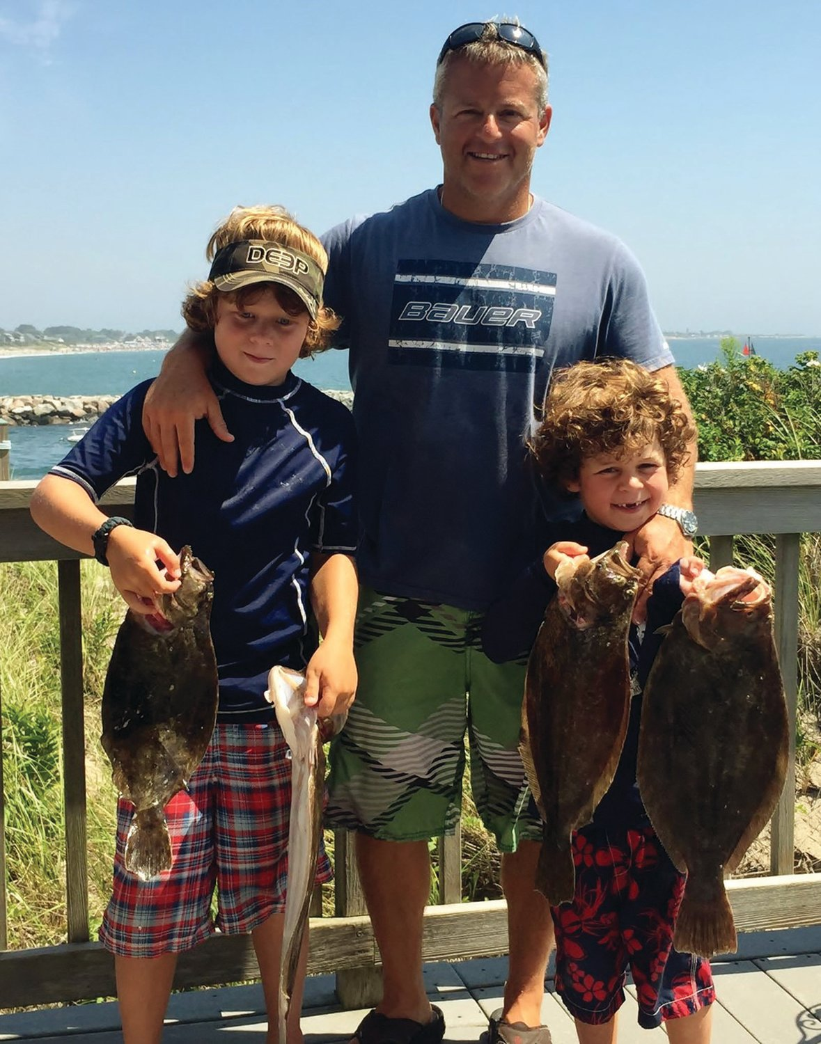 FAMILY FLUKE: Memories of a lifetime created by the Monti family of Warwick catching summer flounder four years ago. Anglers are being asked to weigh in on proposed regulations for summer flounder, scup and black sea bass by March 16.