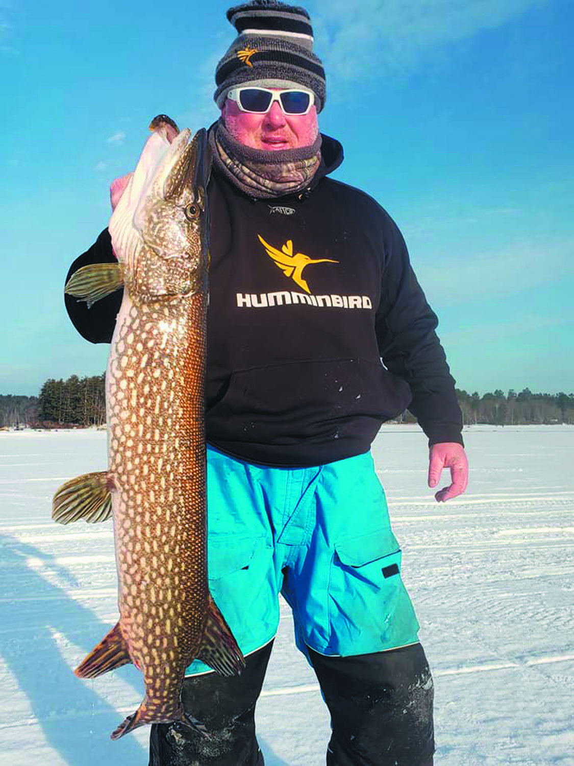 "BIG PIKE: Capt. BJ Silvia of Flippin-Out Charters (Portsmouth) with fishing partner Greg Vespe (Tiverton) and friends had a pick-up ice fishing tournament this weekend at Lakeside Lodge & Marine, Winthrop, Maine. ""The fishing was outstanding,"" said Capt. Silvia."
