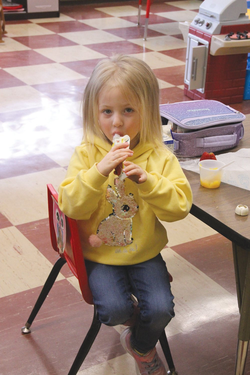 LUNCH BREAK: Samantha Price, who is in pre-school, enjoys a lunch treat.