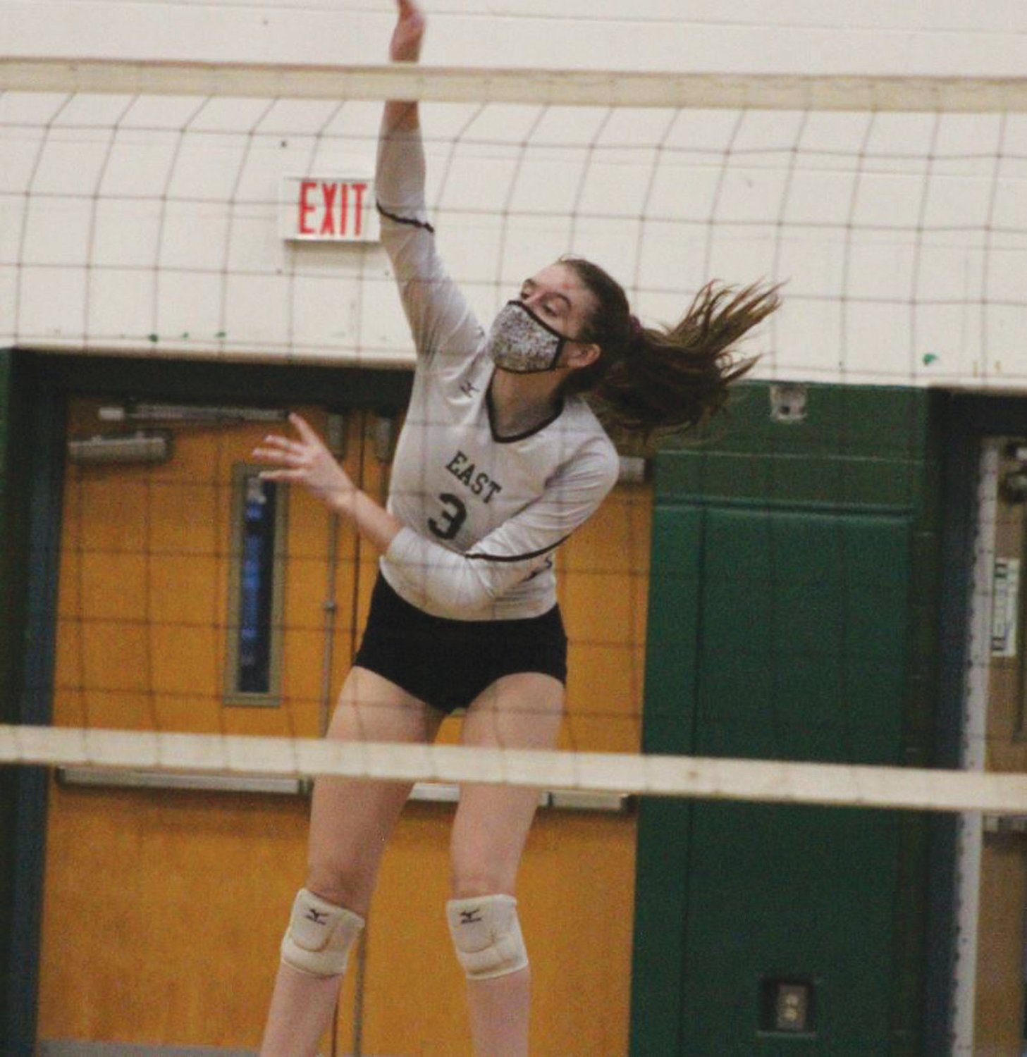 COMEBACK WIN: Cranston East's Lauren Milani jumps to spike the ball last week during the team's season opener against visiting Coventry. Despite dropping the first set to the Oakers, the Lady Bolts would surge to win three straight to complete the comeback victory.