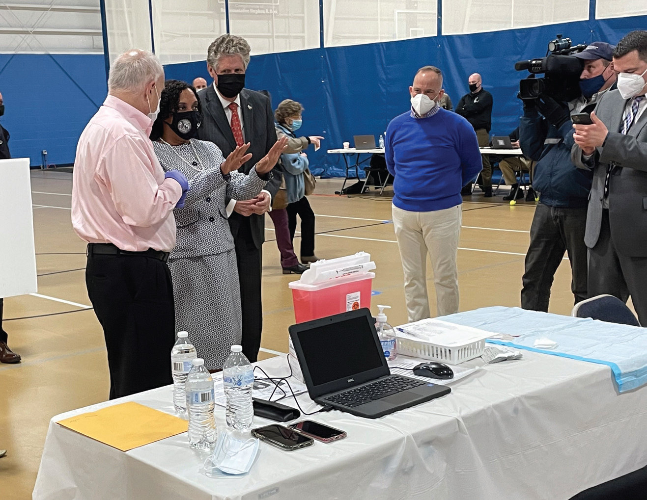STEPPING UP: Providence City Council President Sabina Matos, center, visits the COVID-19 vaccination clinic at the Johnston Recreation Center on Wednesday. Looking on are Johnston Mayor Joseph Polisena, left, and Gov. Dan McKee.