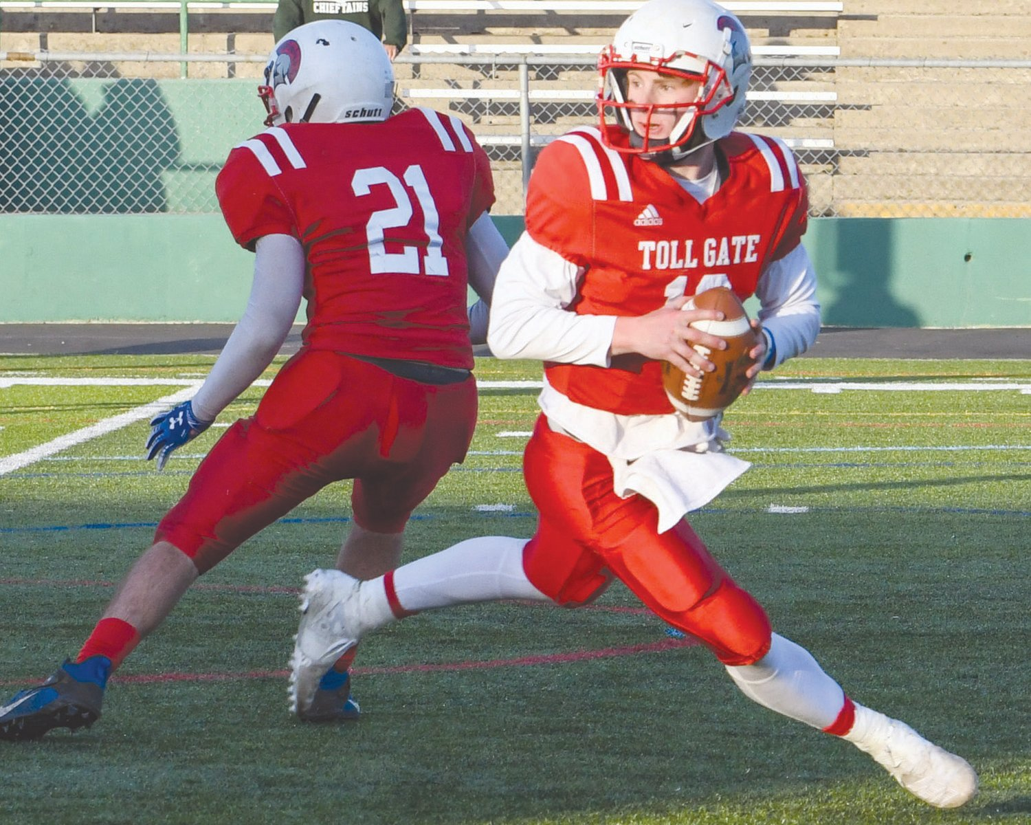 ROLLING OUT: Toll Gate senior quarterback Greyson Pasquina rolls out to pass against Ponaganset last weekend at Cranston Stadium. The visiting Chieftains would shut out the Titans 33-0, who fell to 1-1 with the loss. Toll Gate will be squaring off against Davies this weekend.
