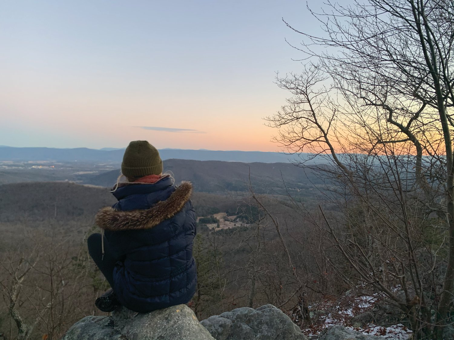 Madeline meditates atop a mountain in West Virginia.