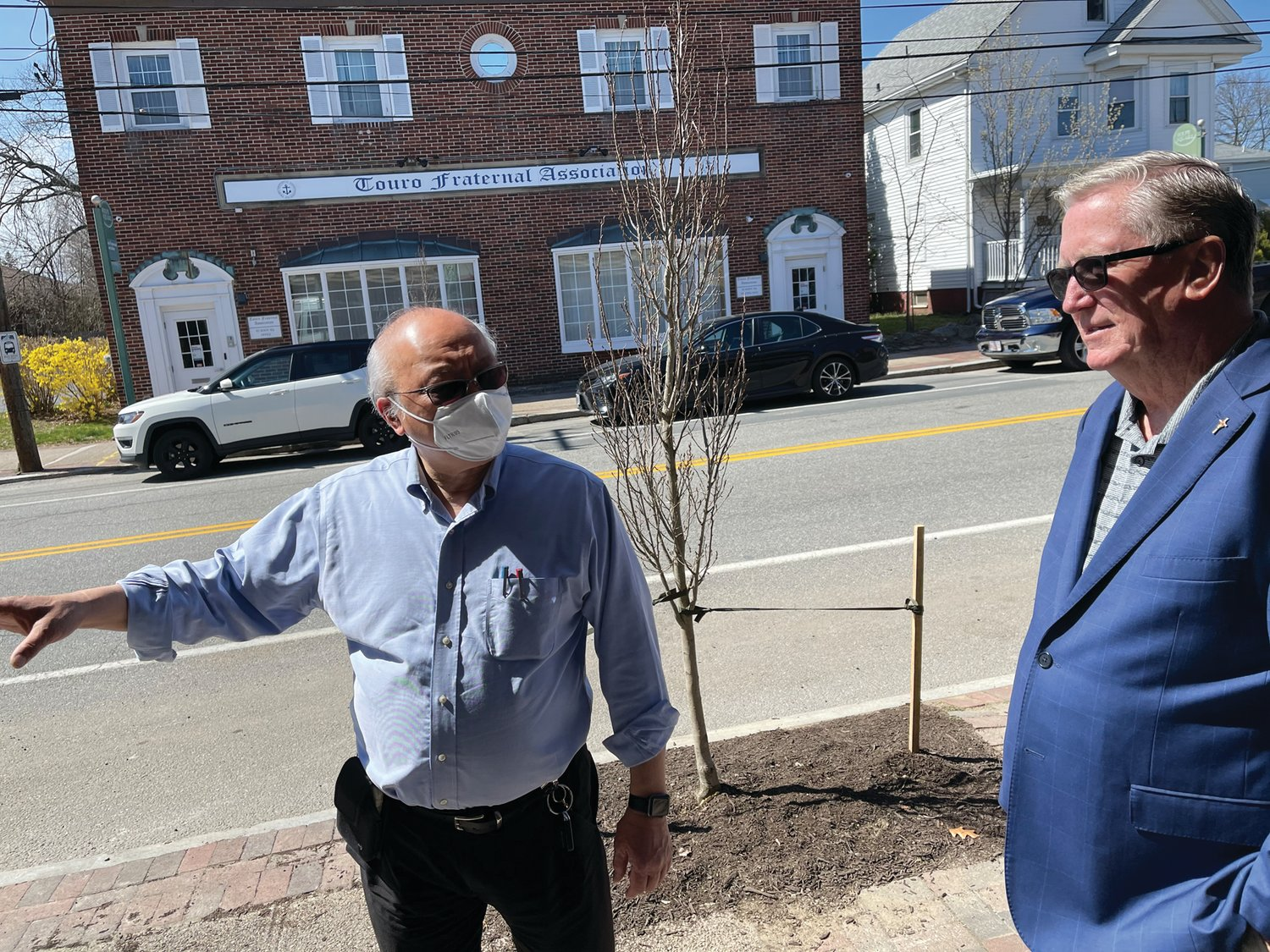 MEETING UP: Charlie Chin, left, a restaurateur and property owner on Rolfe Square, chats with Mayor Ken Hopkins outside Coffee & Crumbs last week. (Herald photos)