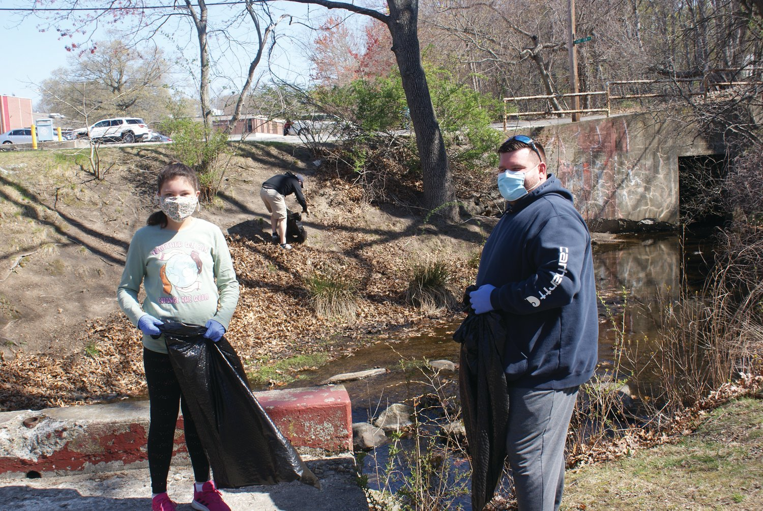 A FAMILY MATTER: City Council President Chris Paplauskas, who represents Ward 5, hosted an Earth Day cleanup at Meschanticut Park on Saturday. He is pictured with his daughter, Sophia, who helped her father throughout the event.