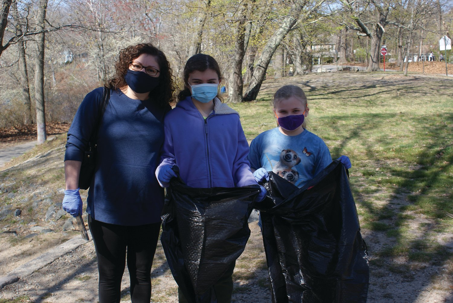WORKING TOGETHER: Working as a wonderful team during the Earth Day cleanup at Meschanticut Park were Judy Insana and her two daughters, Adrianna, 10, and Alyssa, 7.