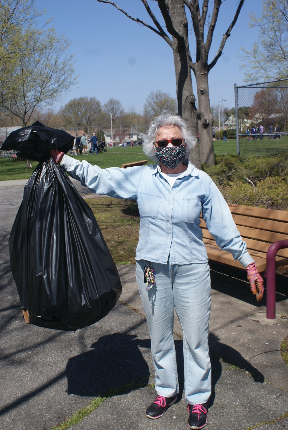 COMMUNITY SPIRIT: Claire Taraborelli, a young resident of Cranston, volunteered her time during the Doric Park cleanup.
