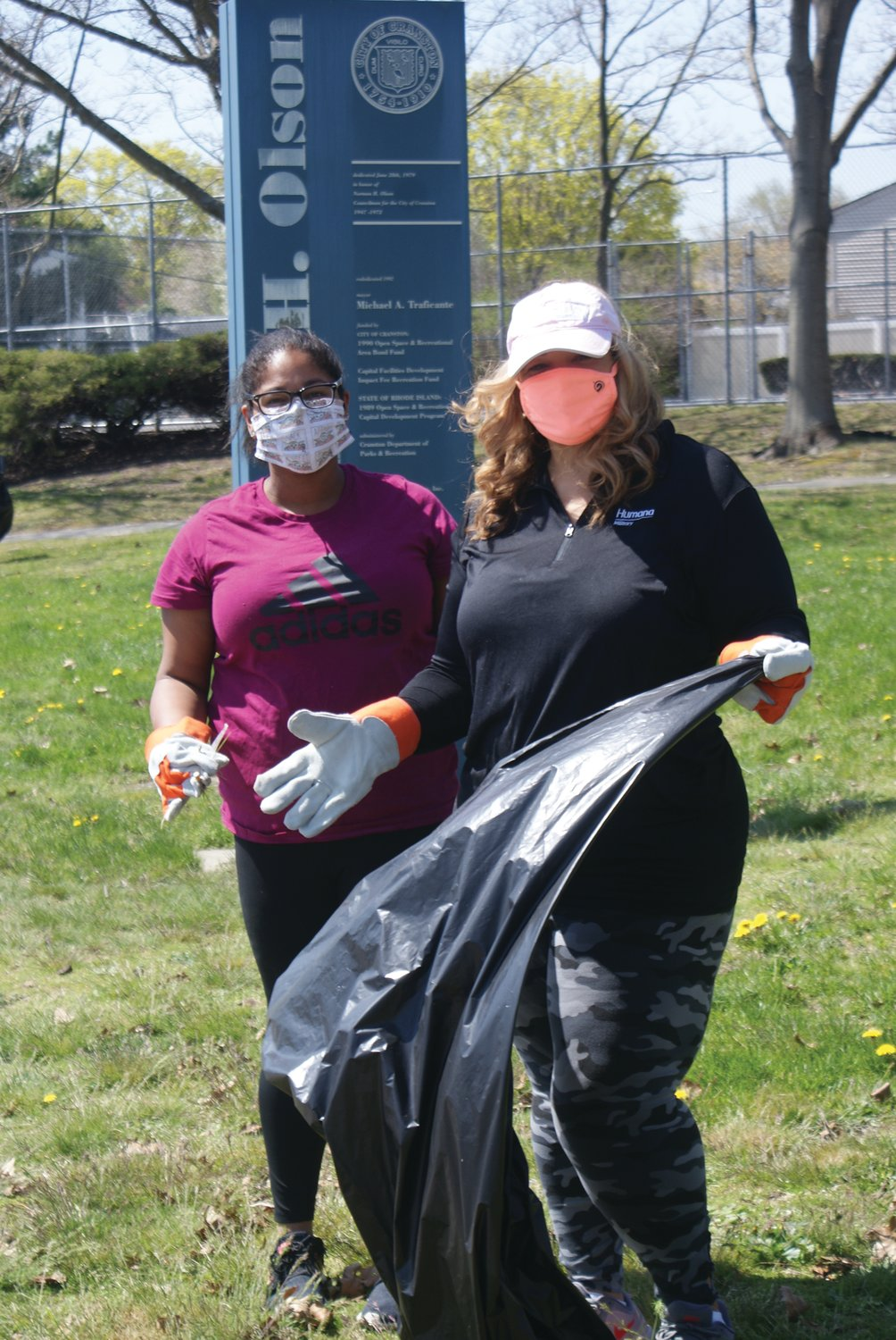 DAY AT THE PARK: Laura Genereux and her mother, Eugenie, worked together at the Earth Day cleanup at Doric Park.