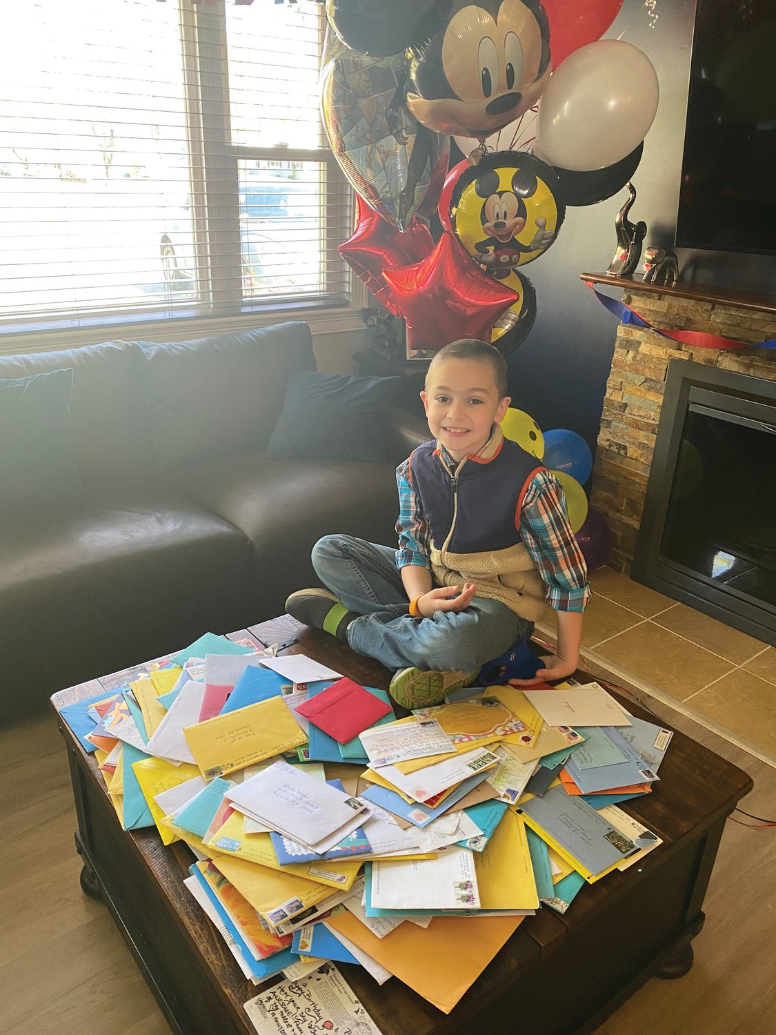 BIRTHDAY BOY: Brady Wright spent his 9th birthday opening over 200 cards from across the United States. His favorite postcard is one from North Carolina, with a picture of the USS North Carolina battleship.
