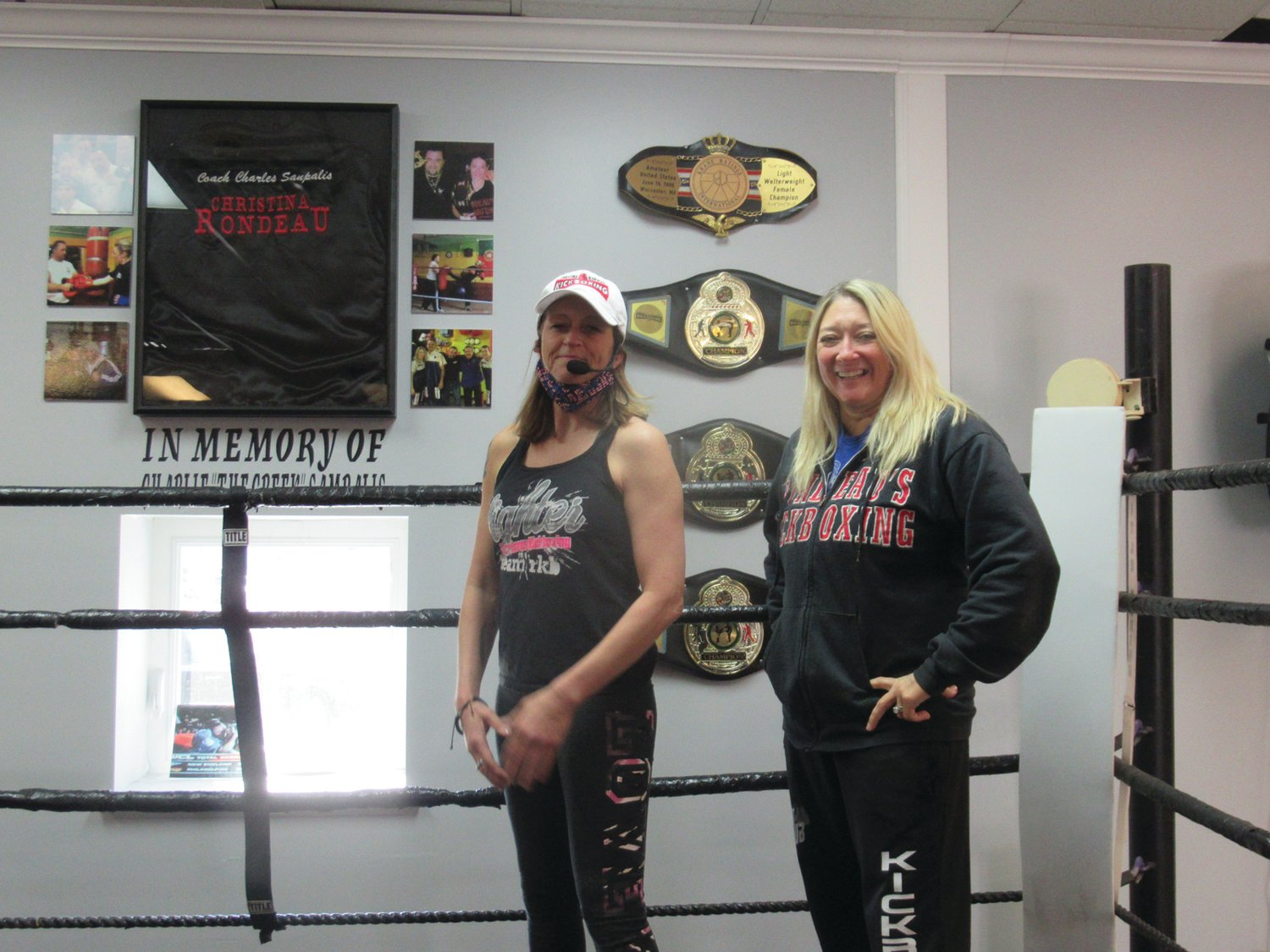 CHAMP'S CORNER: Famed U.S. champion kickboxer and 5th Degree Black Belt Christina Rondeau (right) and Becky Rhodes enjoy a special moment inside the ring during Saturday's special open house.