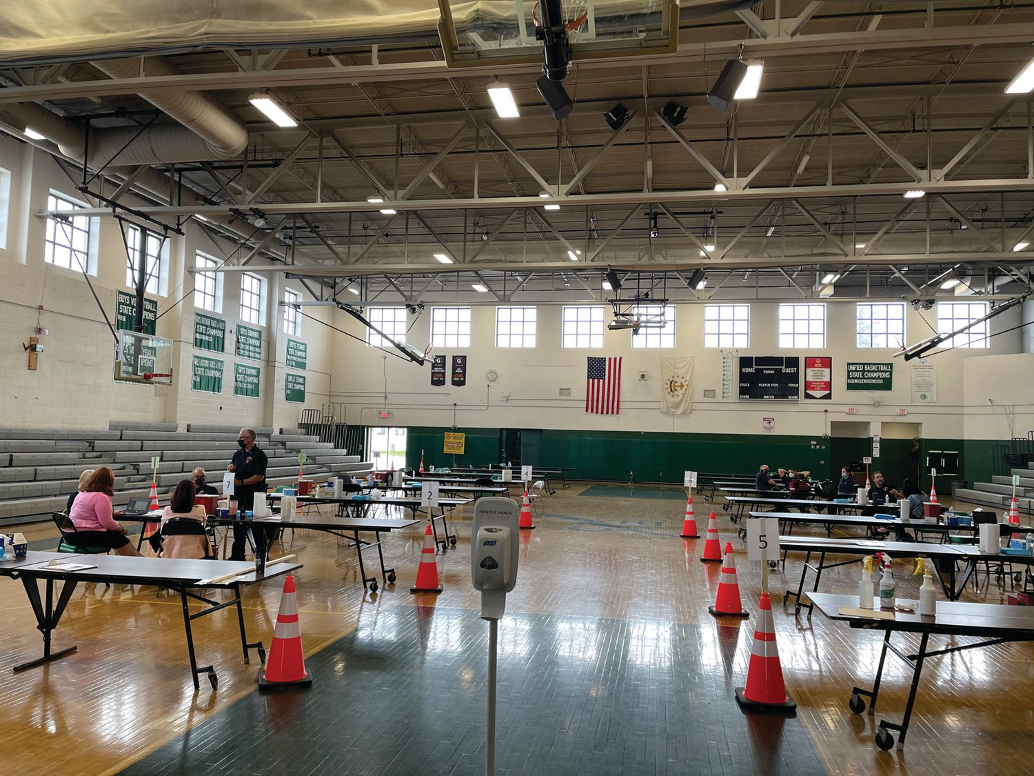 FAMILIAR SETTING: Officials said while demand was lower than initially projected, holding vaccination clinics in school-based settings like Cranston High School East's gymnasium is a vital part of the state's broader effort to make shots as accessible as possible.